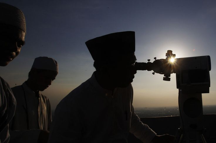 Observing Ramadan | Muslim clerics scan the horizon for the crescent moon that will determine the beginning of the holy fasting month of Ramadan, in Jakarta, Indonesia, on July 8, 2013. | The Atlantic/ AP Photo/Achmad Ibrahim