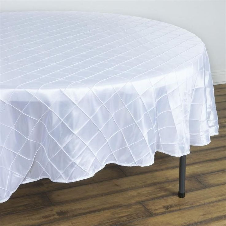 "White Pintuck Tablecloths 90"" Round - Pintuck is actually a fold of fabric that is stitched intricately to hold it in a place, very much like a pleat. These lovely pleats impart a decorative effect to the fabric by fashioning a visual line at a chosen point. They effortlessly bridge vintage and contemporary styles to create a majestic new classic look. If you do not want your celebration to blend in with other weddings, birthdays, and anniversaries, try our premium quality pintuck…"