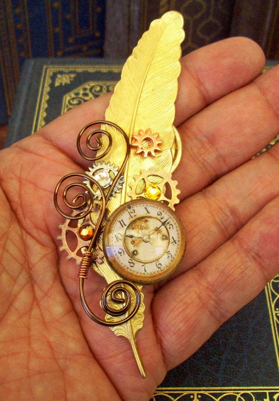 Steampunk Hat Pin or Brooch (HA33) - Raw Brass Feather - Glass Clockface Cabochon - Gears - Swarovski Crystals. $ 34.00, via Etsy.