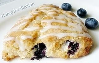 <p>I am always in happy land when blueberries are around.  :-)</p><p>A few days ago I got even happier.  AJ left a comment on my blog that directed me to his blog - AJ's Cooking Secrets.</p><p>Which is where I saw the recipe for these blueberry scones.  I immediately knew what I would be using the blueberries I had just bought for!  AJ made Tyler Florence's recipe for blueberry scones.  I went to the Food Network site and read the reviews on Tyler's scones.  Several people were having…