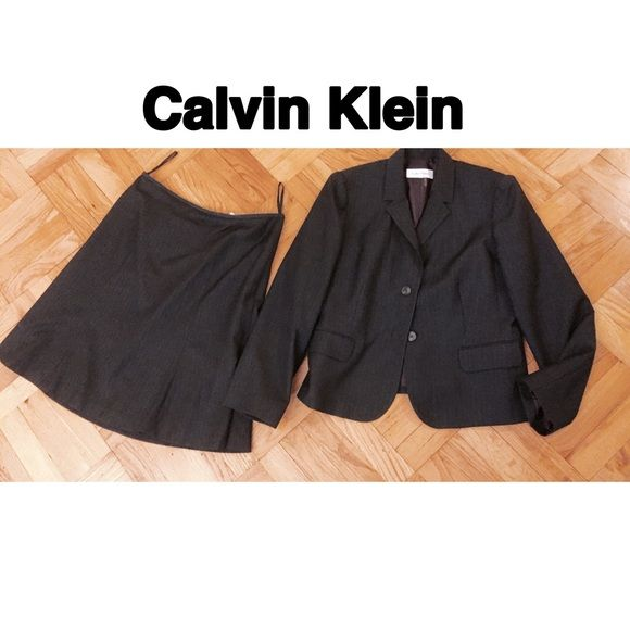 Gray striped Tulip Skirt Suit Pre loved and in perfect condition. Dark gray Calvin Klein skirt suit. Jacket has two front buttons. Tulip skirt with back zipper. Great material can withstand traveling in a suitcase. Perfect for work or interviews. Price is not firm please use the offer button. Calvin Klein Skirts Skirt Sets