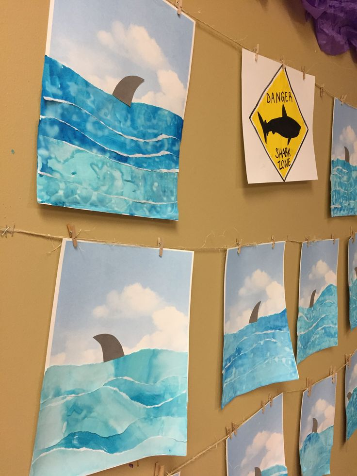 Ripped water color paper to create ocean on sky paper with shark fin art project…