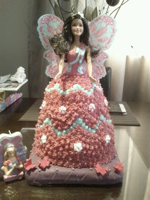 Butterfly Barbie cake. Yummy hand carved vanilla/choc marble cake with simple icing