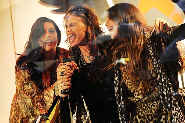 October 14: Mia Tyler, Steven Tyler and Chelsea Tallarico attend the Andrew Charles fashion line launch at Macy's Herald Square in New York.