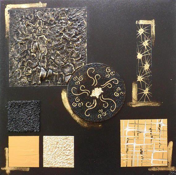 Tableau mural contemporain noir or doré Arché - « Arché » est une toile acrylique résolument contemporaine en relief qui donnera à votre intérieur une touche de modernité.  Dimensions (cm) : 50 cm X 50 cm Format : carré Matériaux utilisés : technique mixte, acrylique et association de différents médiums et matériaux inédits sur châssis toilé Particularité : en relief