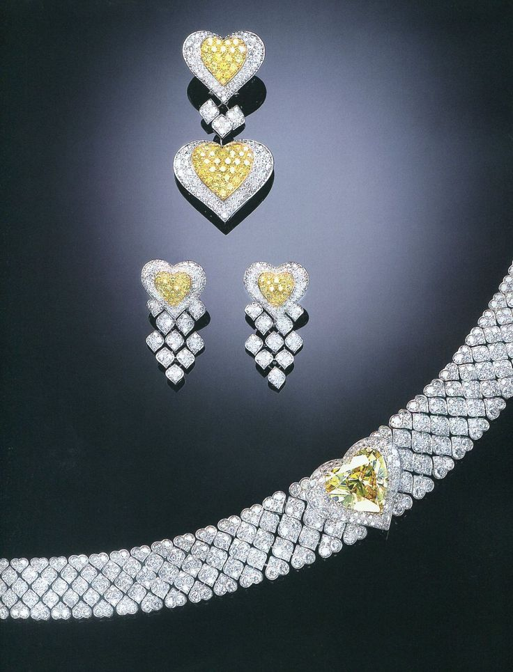 A SUITE OF MAGNIFICENT FANCY YELLOW DIAMOND AND DIAMOND JEWELLERY, BY TABBAH