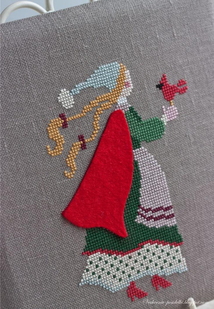 Pretty Winter girl in cross stitch