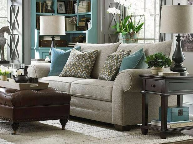 Nice gray-blue-espresso color palette in this family room.  Furniture looks a little stiff to me though.  Not the kind of sofa to sink into.  Maybe more appropriate for formal living room???