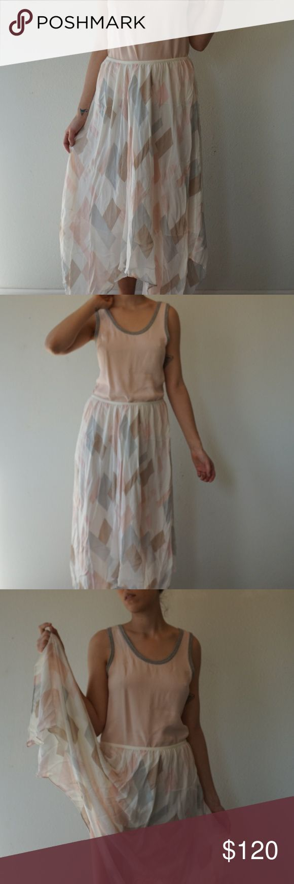 Fun Joie Silk Skirt Beautiful Joie silk skirt in good condition.  Fun pattern for spring!  Just too big for me :(  Stretch waistband.  Zara top (pictured) is also for sale. Joie Skirts Asymmetrical