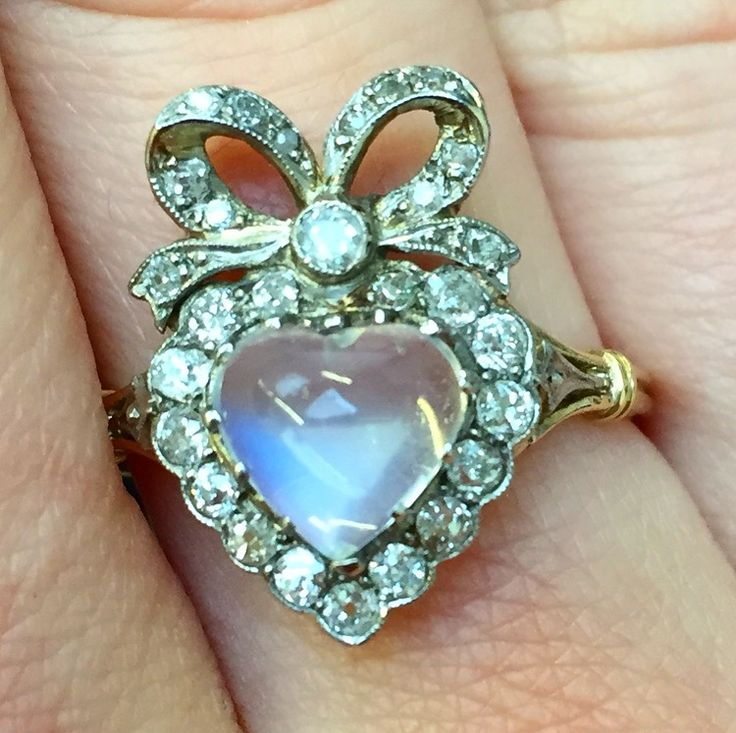 A close-up shot of the gorgeous moonstone and diamond heart ring featuring in our July Antique & Modern Auction. London viewing is taking place tomorrow and Wednesday, call to book an appointment #fellows #auctions #showmeyourrings #moonstone #heart #antiquejewellery #auctionpicks