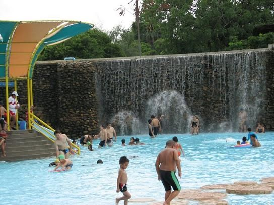 Waterfall and swimming pool at the Siam Park City in Bangkok, Thailand