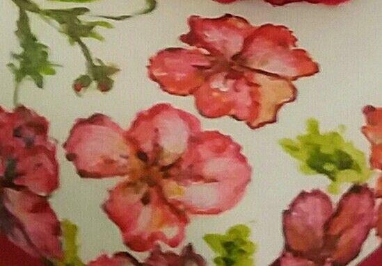 Lola's Delights signature geraniums painted on fondant