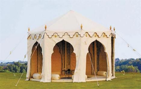 A large and exotic fabric Tent with Middle-Eastern inspired arched door ways
