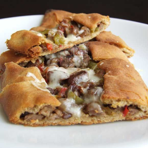 Turkish pizza pide topped with chopped beef and melting cheese | http://giverecipe.com | #pizza #turkish #pita