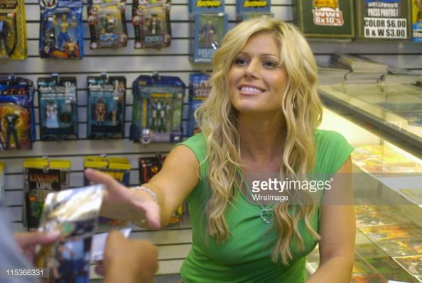 WWE Diva and Playboy Playmate Torrie Wilson signs autographs at RVD 5-Star Comics at the Lakewood Center Mall in Lakewood, Calif. on Thursday, August 19, 2004.