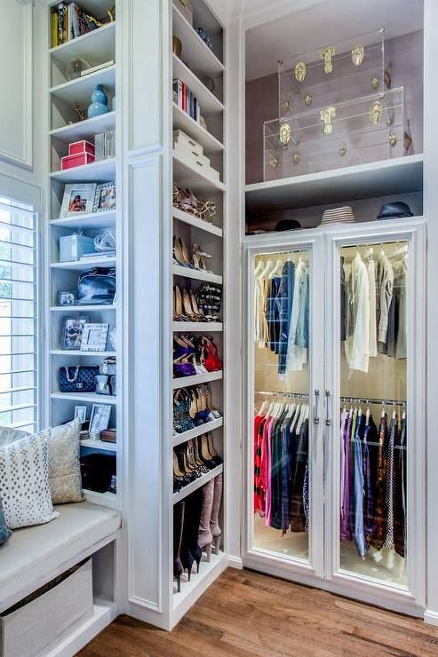 walkin closet boasts a builtin window seat flanked by floor to ceiling shoe shelves