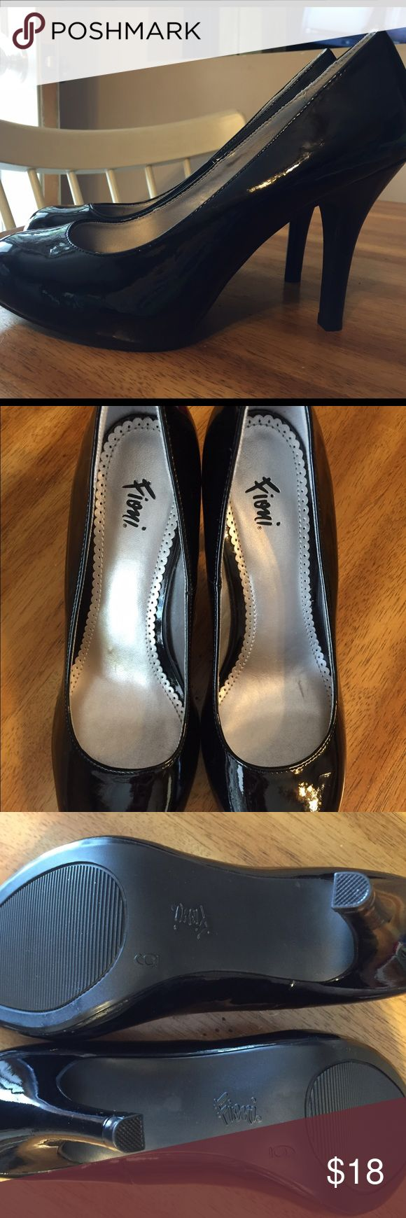 Brand new Fiona black patent high heel shoe size 6 Hard to find- Rounded Toe- Brand new Fiona black patent high heel shoe size 6. Never worn as you can see by pic. Small scuff line across right toe. Not noticeable from a few inches away. FIONI Clothing Shoes Heels