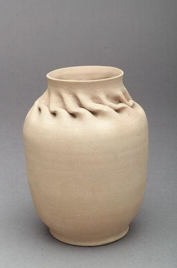 A George Ohr Unglazed Ceramic Vase, c. 1899-1906, crimped around the neck, signed �G.E. Ohr� in sgraffito, height 7 3/8 in.,