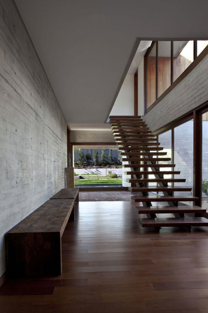 Wooden Bench On Grey Wall Near Wooden Stairs For Upper Level