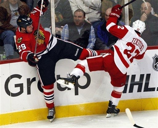 14a94f636 ... Chicago Blackhawks Bryan Bickell (29) and Detroit Red Wings Jordin  Tootoo ...