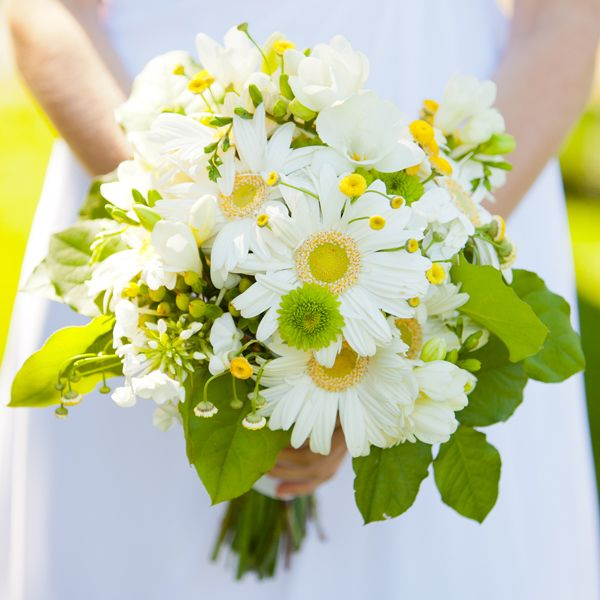 Daisy's have always been one of my favorite flowers and this bouquet has the perfect amount of yellow and green. I love the natural look you get when they use leaves on the bottom of the bouquet. Photo Credit: Photography by Jen Philips