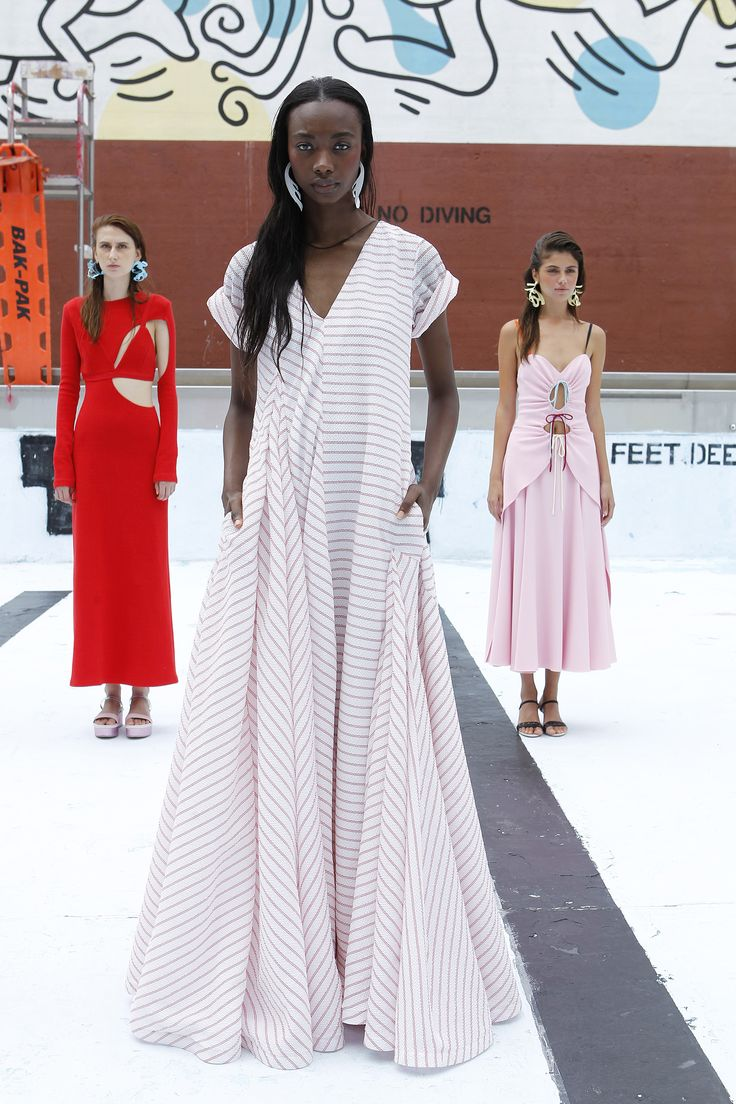 Dresses in pink and cherry red were spliced with bikini shapes and swim-like cut-outs and cinches. But it was the oddball gowns that stood out. A striped oversized t-shirt gown landed somewhere between evening and caftan. But it was 100% cozy and covetable.    - HarpersBAZAAR.com