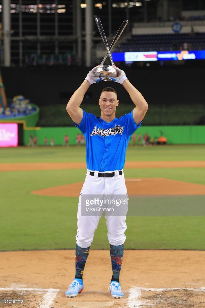 Aaron Judge #99 of the New York Yankees celebrates with the trophy after winning the T-Mobile Home Run Derby at Marlins Park on July 10, 2017 in Miami, Florida.