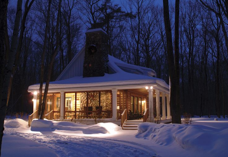oh yes a screened porch with an indoor/outdoor fireplace surrounded by woods