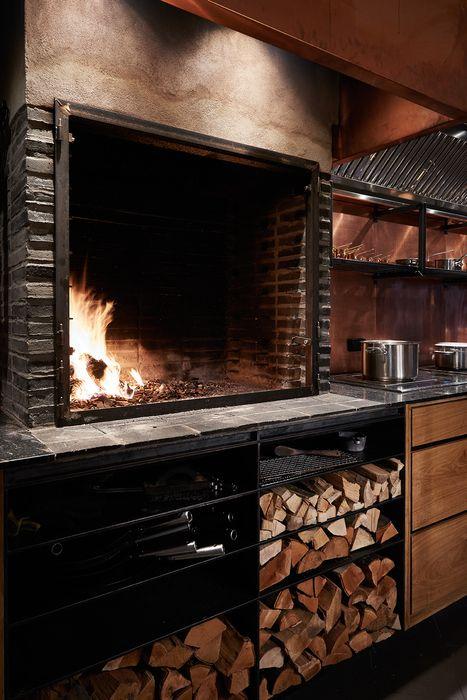 Kadeau (Copenhagen, Denmark), OEO Studio. large open cooking fire in kitchen