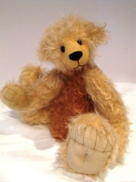 Nimo - approximately 12 inches and has very large feet.