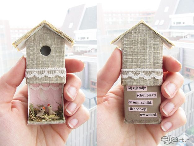 A tiny little bird house made from a matchbox, some lace tidbits, and a little smidge of clay for the birds.