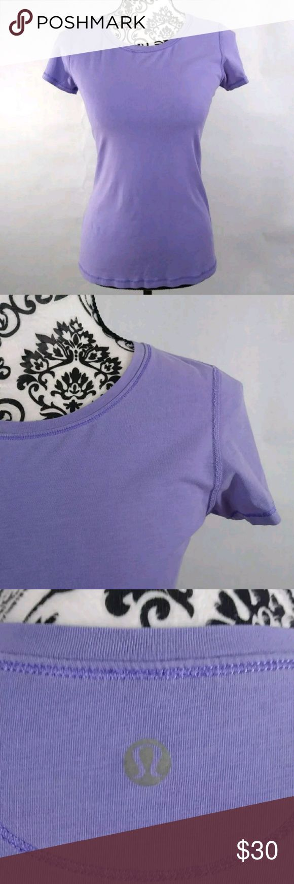 """Women's Lululemon purple shory sleeve shirt size 8 Women's light lilac purple active t-shirt. Lululemon size 8. This is a pre-owned item and the tag has been removed per Lululemon instructions so size is listed according to measurements (Please double check measurements upon purchase. Purple stitching compliments this crew neck tee as well as the signature Lulumon logo on the upper back.  Measurements:  Pit to Pit  16""""  Shoulder to Hem  26""""  Comes from a smoke free home!  This is a…"""