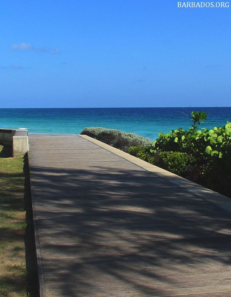 Strolling the Barbados south coast boardwalk under sunny skies :)