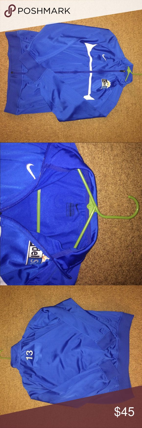 Nike soccer jacket This was my old soccer jacket. Size youth extra large , fits an adult small and is a loose fit on me. I don't ever wear it anymore it's been worn a decent amount of times. No signs of wear or tear and no stains. Smoke free home. Nike Jackets & Coats