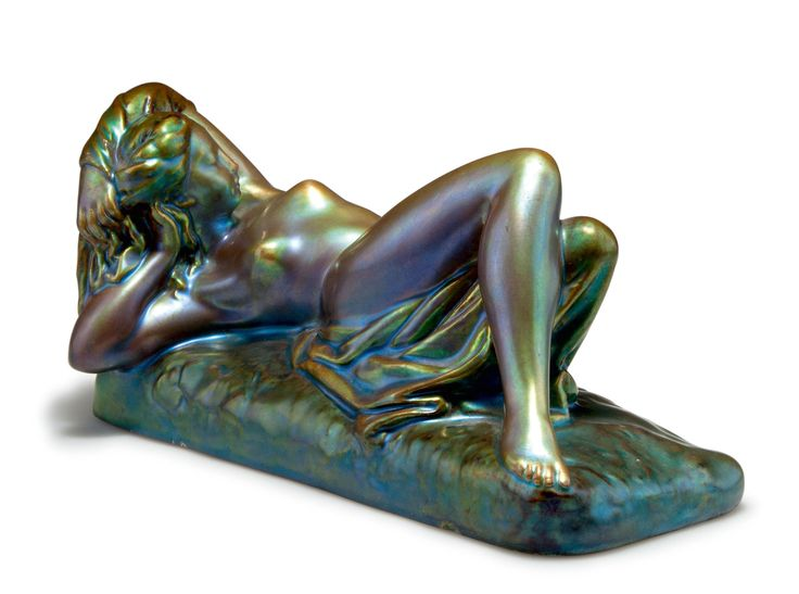 Zsolnay, Pécs. Reclining nude, priort to 1918. H. 11 cm, 22.1 x 11 cm. Earthenware, eosin glaze, green/golden and wine red. Marked: Seal. 14/700E