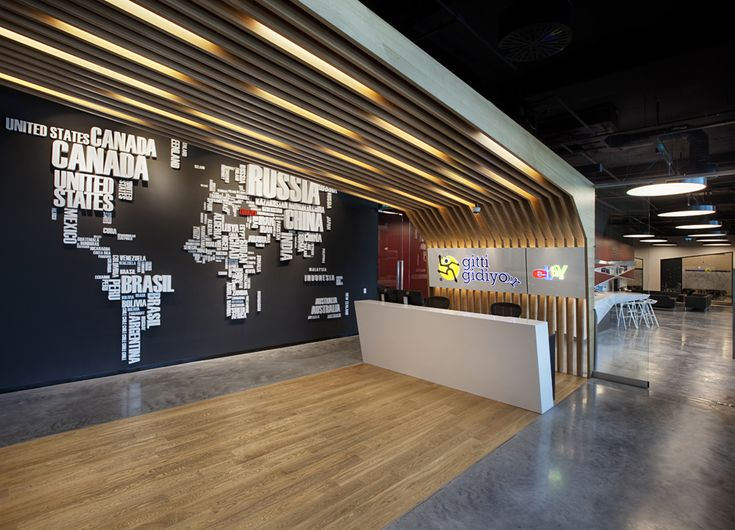 """Ebay, 200,000 sqft office in Istanbul, designed by architecture firm OSO Mimarlik.  """" ... Ebay's global existence and the fact that you are in the Turkish office in time being is symbolized with the stylized world map and red colour Turkey perception in the left of entrance hall."""""""