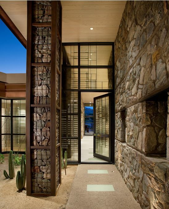 Gabion Column Leading To A Glass Metal Front Door In Az Metal Cage Filled With Stones
