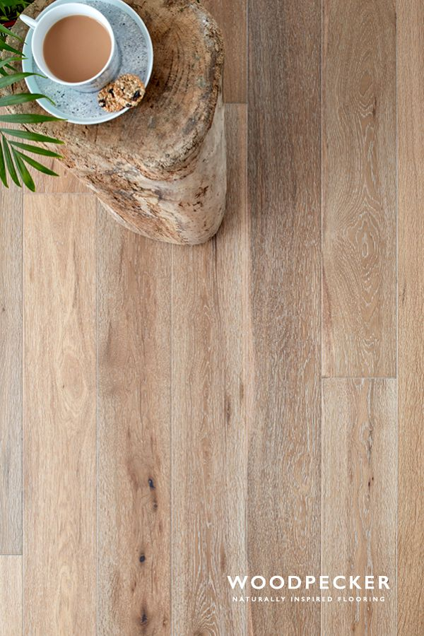 This white smoked oak floor has an allure of the unexpected in every twist and turn of its tones. Get a free sample at our website.