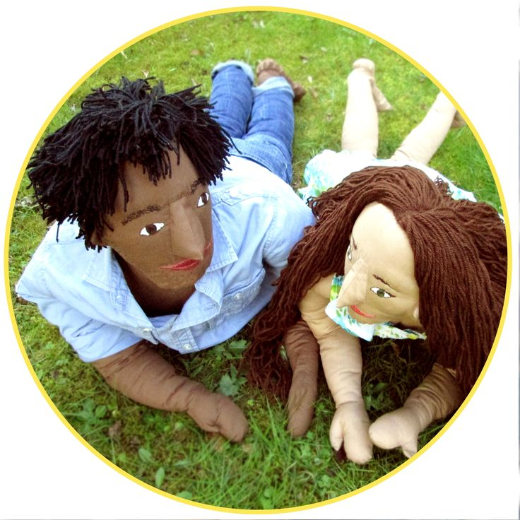 Two custom puppets, Josie and Tim, are enjoying planning their future together in the sunshine.