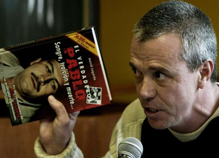 "In this  June 27, 2006, file photo, John Jairo Velasquez, a former hit man for Pablo Escobar, gives his testimony while holding a book titled ""The True Pablo, Blood, Treason, and Death,"" during the trial against Alberto Santofimio Botero in Bogota, Colombia. Velasquez, better known by his nickname ""Popeye,"" was released Tuesday Aug. 26, 2014, under heavy police surveillance from a maximum security prison northeast of Bogota after 23 years behind bars for plotting the murder of a former…"