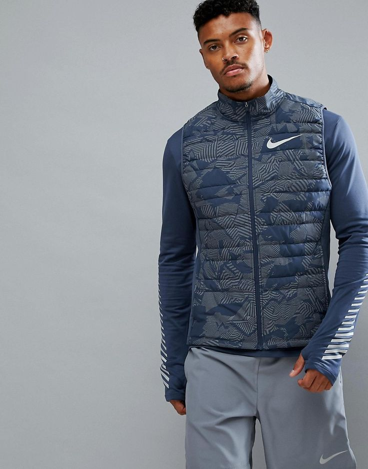 Get this Nike Running's vest now! Click for more details. Worldwide shipping. Nike Running Flash Reflective Gilet In Navy 859214-471 - Navy: Gilet by Nike, Supplier code: 859214-471, Smooth durable fabric, Lightweight padding for warmth, Funnel collar, Zip fastening, Nike Swoosh logo to chest, Sleeveless design, Reflective details for enhanced visibility in low-light conditions, Regular fit - true to size. Get the most out of your runs with Nike Running�s range of activewear. Ace your base…