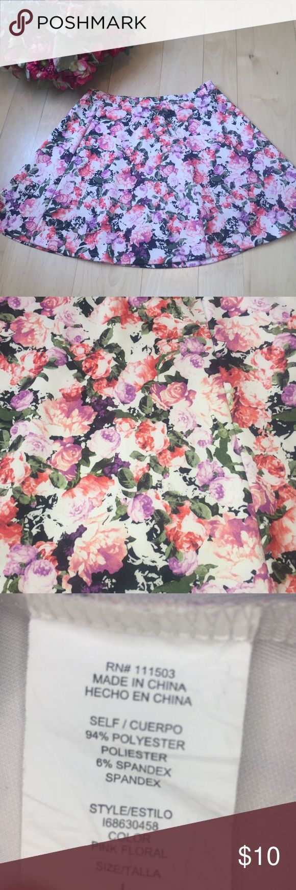Coral floral print skirt Circle mini skirt with coral and purple flower print (second picture shows more of the true colors of the skirt). Gently worn. 15 inches at waistband. 17 inches from top of waistband to hem. Skirts Mini