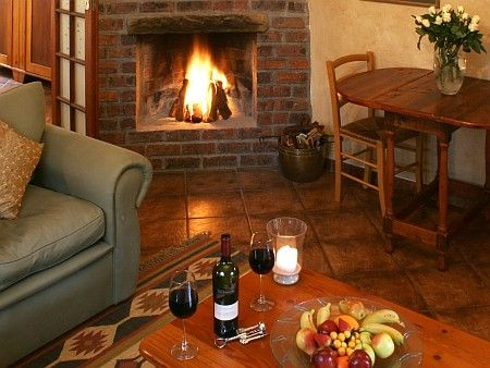 Self catering accommodation, Noordhoek, Cape Town  Perfectly cosy lounge fire for those wintery nights