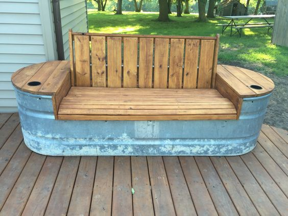 Galvanized stock tank bench with hinged seat for storage / #repurposed #stock #tank #bench