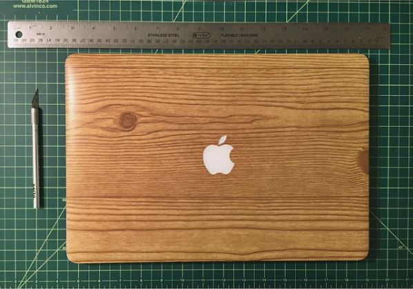 Give your laptop an upgrade by covering it with wood-grain contact paper from the dollar store. | 21 Ingenious Dollar Store Ideas You'll Want To Try