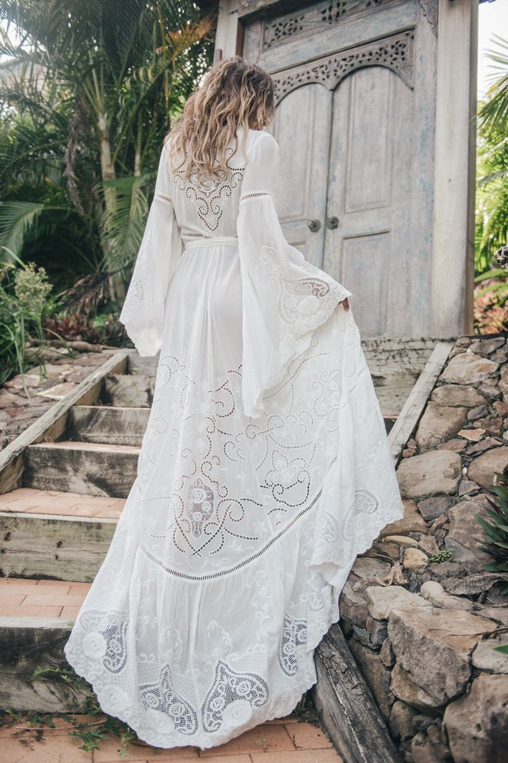 The Magnolia gown is a beautiful draping gown made in a divinely light crinkle silk with a relaxed fit and a gentle kimono sleeve. The gown is detailed with delicate pin tucks on front and back, mesh lace and intricate trims. We imagined this gown being worn by a barefoot bride, ocean side or in a field of daisies. size & fit  Model is 165cm and is wearing a size XS. Waist -XS: 97cm | S: 102cm | M: 103cm | L: 112cm | XL: 117cm Bust -XS: 101cm | S: 106cm | M: 111cm | L: 116cm | XL: 121cm...