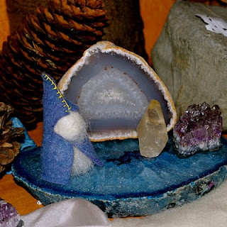 crystals on this winter nature table.  I like the idea of a nature table for each season and of course I love rocks...I like the sense of being connected to the outdoorsy part of the Christmas season...