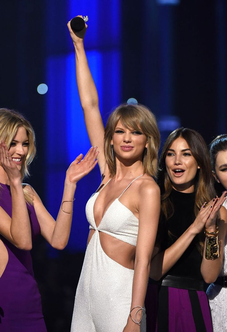 Martha Hunt, recording artist Taylor Swift, model Lily Aldridge and actress Hailee Steinfeld speak onstage during the 2015 Billboard Music Awards