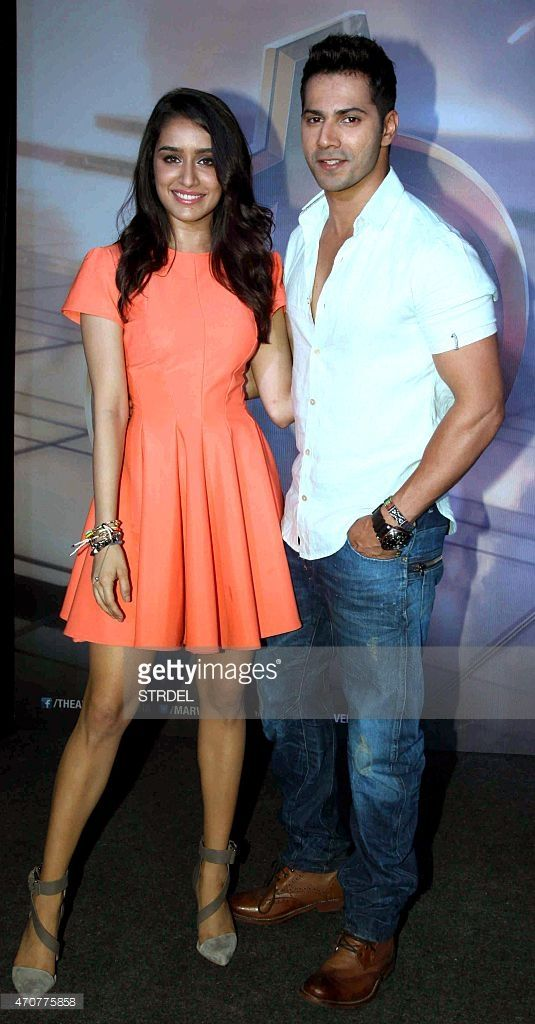 Indian Bollywood actors Shraddha Kapoor (L) and Varun Dhawan pose for a photograph during a screening of Hollywood film 'Avengers - Age of Ultron' in Mumbai on late April 22, 2015.