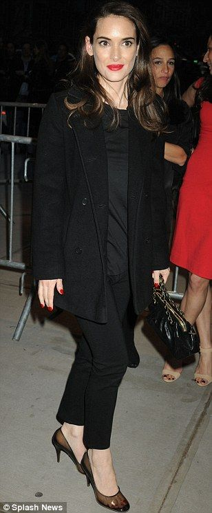 Pop of red: Winona Ryder arrived for the event looking more refreshed than ever with glowing skin and a red lip